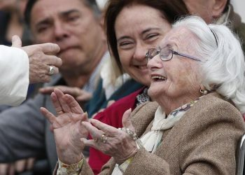 """An elderly woman reacts as she meets Pope Francis during his general audience in St. Peter's Square at the Vatican in this March 22, 2017, file photo. The pope has chosen the theme """"I am with you always,"""" for the first World Day for Grandparents and the Elderly, to be celebrated July 25. (CNS photo/Paul Haring)"""